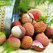 Several lychees beside metal box