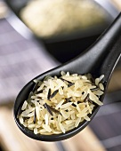 Long-grain rice and wild rice on Asian spoon