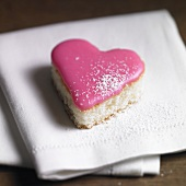 Heart-shaped petit four with pink icing
