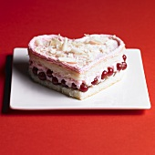 Heart-shaped sponge cake with redcurrants and cream