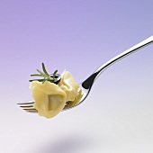 Tortellini with rosemary and olive on a plate