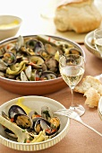 Shellfish and vegetables with bread and white wine