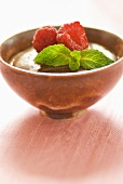 Bowl of mousse au chocolat with raspberries