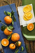 Whole oranges with leaves and orange slices