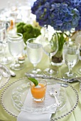 Elegant place-setting with glass of cold soup
