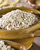Buckwheat flakes in terracotta pot
