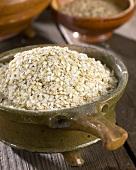 Quinoa flakes in terracotta pot