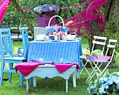 Table laid for picnic in garden