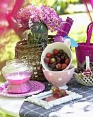 Fruit yoghurt, strawberries and cherries on garden table