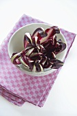 Radicchio di Treviso in a bowl on a tea towel