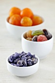 Candied fruit in three small bowls