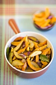 Roasted pumpkin slices with red onions and pear slices