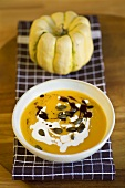 Pumpkin soup with pumpkin seeds and creme fraiche