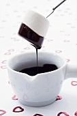 Chocolate fondue with marshmallow, confetti hearts