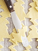 Christmas tree shapes cut out of sweet pastry