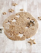 Unbaked cinnamon stars with dough and cutters