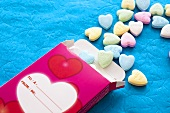 Box of coloured sugar hearts