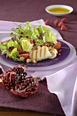 Lettuce with Halloumi cheese and pomegranate seeds