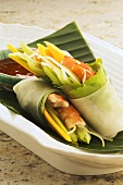 Wraps filled with prawns, mango and cucumber, chilli dip