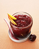 Cherry and mango jam in screw-top jar
