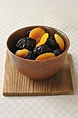 Prunes and dried apricots in bowl
