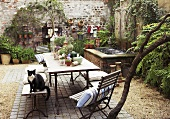 Romantic interior courtyard with plants, fountain and table