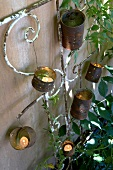 Tealights in old tin cans (garden decorations)