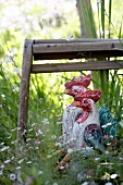 Hen figures on garden seat