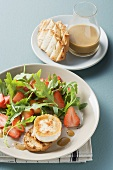 Rocket and strawberry salad with baked cheese and mustard dressing