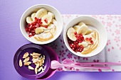Banana salad with pomegranate seeds on yoghurt and almond puree