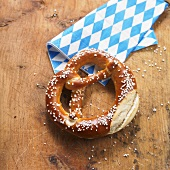 Soft pretzel and blue and white napkin