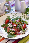 Salad leaves with strawberry vinaigrette