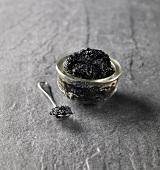 Black caviar in small glass dish