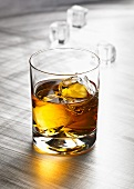 Glass of whisky with ice cubes