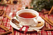 Cup of tea with sugar swizzle stick (Christmas)
