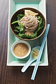 Buckwheat noodles with spinach and sesame seeds