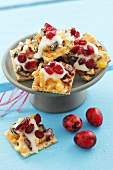 Waffles with dried fruit, cranberries and icing for Easter
