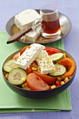 Sweetcorn, cucumber, tomato and red pepper salad with sheep's cheese