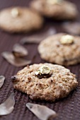 Hazelnut macaroons with gold-coated nuts