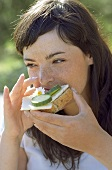 Young woman eating bread and cheese