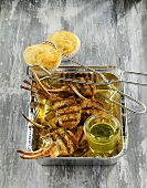 Grilled lamb cutlets with herb sauce and cheese muffins