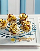 Olive semolina cakes with marinated aubergine
