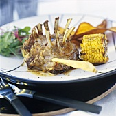 Wild boar chops with corn cobs and sweet potatoes