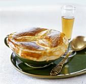 Crab cream soup under puff pastry crust