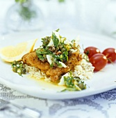 Wild boar escalope with boiled egg and herbs on rice