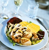 Grilled seafood with mushroom slices and mango