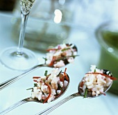 Crabmeat with chives and peppers on spoons