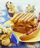 Chips and frankfurter with ketchup