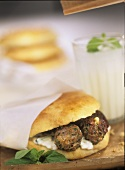 Pita bread filled with lamb meatballs and feta