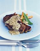 Beef steak with pepper cream sauce